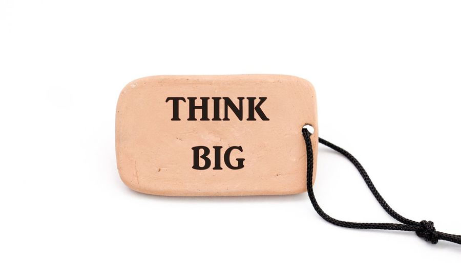 think big concept Think BIGGER Clay Work Close-up Communication Concept Data Information Medium No People Single Object Single Word Studio Shot Text Think Big White Background