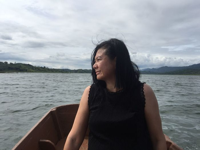 Mature woman traveling in boat