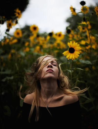 Portrait of woman with yellow flowers