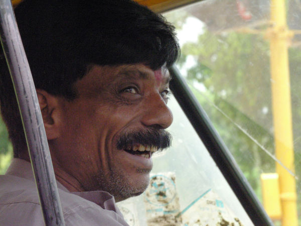Smiling rickshaw driver in Delhi, India. All Smiles Characters Delhi Drivers Happy India Moustaches Portraits Rickshaws Smiles Tourism Transport Travel Workers