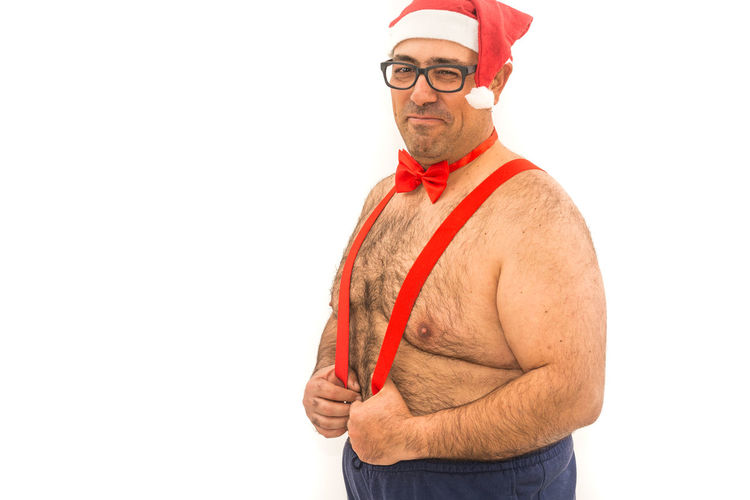 Santa Claus Adult Arms Crossed Cap Clothing Copy Space Cut Out Facial Hair Glasses Hat Males  Men One Person Portrait Red Standing Studio Shot Waist Up White Background