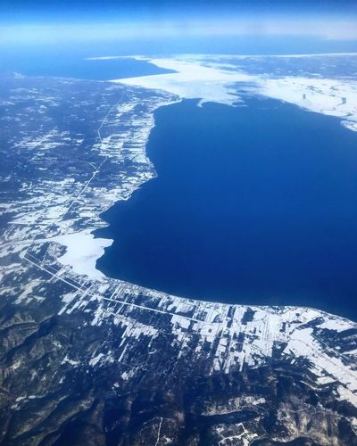 Beauty In Nature Water Winter Nature Snow Sea Cold Temperature No People Outdoors Tranquil Scene High Angle View Aerial View Tranquility Scenics - Nature Day Blue Land Environment