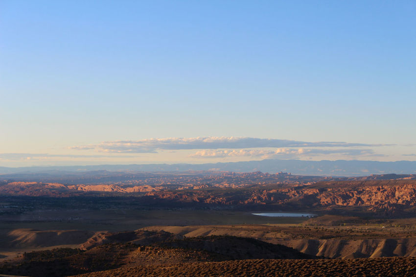 High elevation view of the desert around Moab, Utah. Moab and Arches National Park are visible in the distance. Desert Ken's Lake Moab, Utah Utah Beauty In Nature Day Desert Beauty Desert Landscape La Landscape Mountain Nature No People Outdoors Scenics Sky Tranquil Scene Tranquility Water