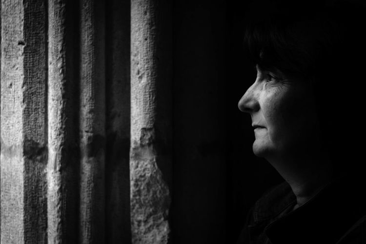 Woman looking away in darkroom