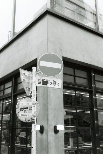 Shibuya, Tokyo, Japan Building Exterior Architecture Text Communication Built Structure Low Angle View No People Outdoors City Day Road Sign Clock Shibuya Shibuya, Tokyo Blackandwhite Traffic Signal