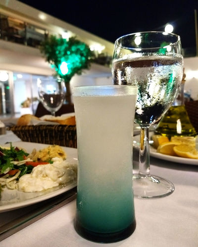 turkish alcohol drink and traditional appetizers Food And Drink Drink Glass Food Close-up Restaurant Alcohol Anisette Aperitif Appetizer Arak Cheers Cold Delicious Dinner Dish Tasty Traditional Rakı Seafood Salad Mediterranean  Meze Turkish Turkish Food