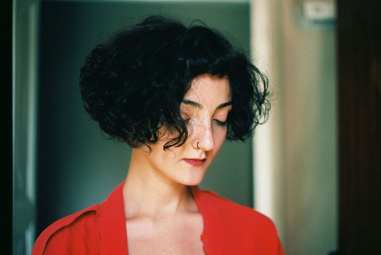 Filmisnotdead 35mm Film Analogue Photography Film Beauty Woman Portrait Woman Red Fashion One Person Headshot Real People Front View Black Hair Indoors  Hairstyle Beautiful Woman Looking Down EyeEmNewHere A New Perspective On Life My Best Photo International Women's Day 2019