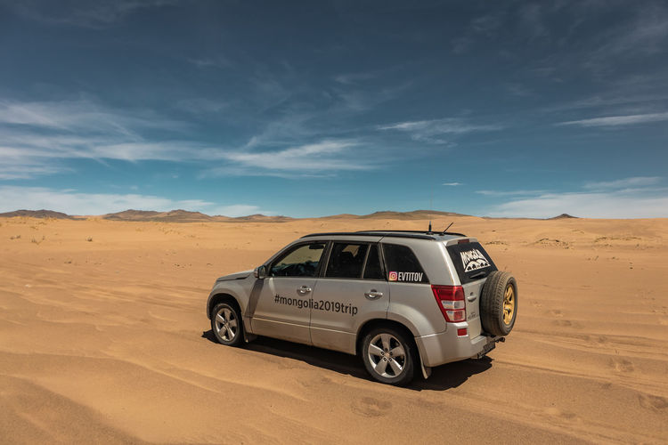 Mongolia Desert Mode Of Transportation Transportation Land Scenics - Nature Sky Cloud - Sky Climate Arid Climate Off-road Vehicle Remote Land Vehicle Sand Car Nature Landscape Environment Travel Non-urban Scene Beauty In Nature 4x4 No People Sports Utility Vehicle