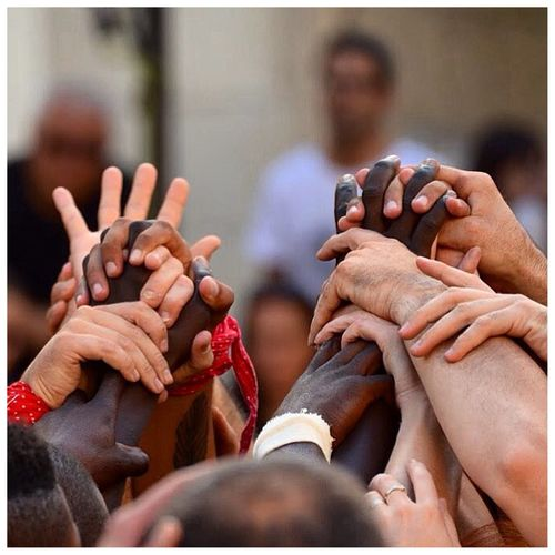 Diverse people holding hands representing unity