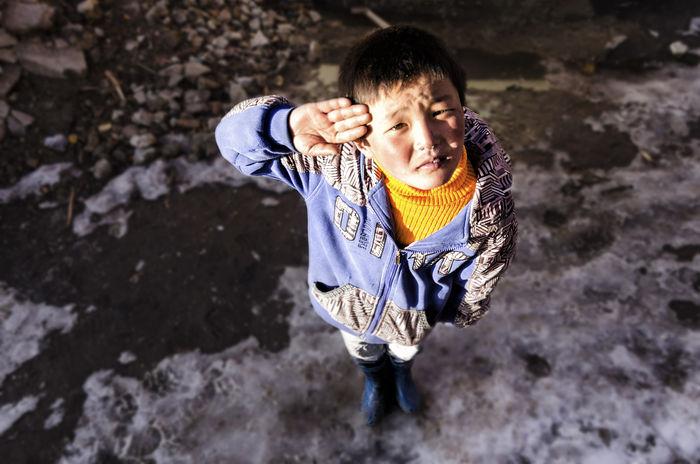 A little kid near Tawang, Arunachal Pradesh. Arunachal Pradesh Boy Childhood Children Happiness Kid Light Looking At Camera My Winter Favorites Orange Portrait Sincere Smile Snow Tawang Travel Winter Young Adult