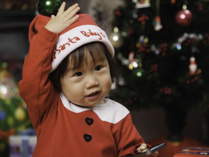 Baby Santa Claus Santa Hat Baby Girl Childhood Christmas Close-up Communication Day Focus On Foreground Indoors  One Person Real People Text