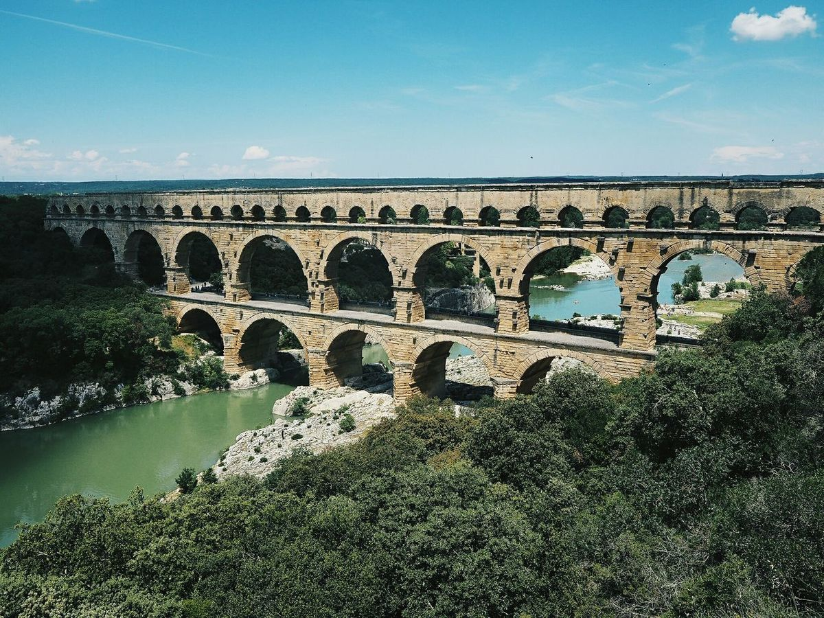 Pont du Gard. Roman aqueduct in southern France. over the Gardon river in Remoulins, close to Avignon. Roman Architecture Aquädukt Pont Du Gard Galloromain World Heritage Bridgeporn Happiness EyeEm Selects Wilderness Travel Quiet Moments France Water Sky Nature No People Architecture Built Structure Outdoors Arch Bridge Connection Blue Bridge - Man Made Structure Transportation