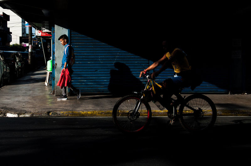 Flaneuring in Color Bike City Life Eyeem Philippines Philippines Shadow Shadows & Lights Street Street Photography Streetphoto Streetphoto_color Streetphotography The Street Photographer - 2016 EyeEm Awards
