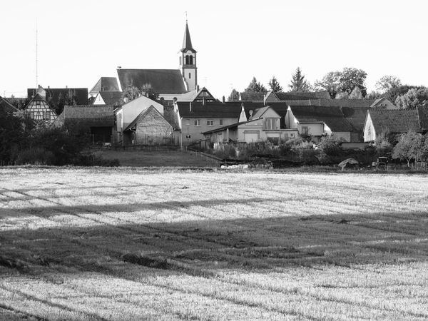 Agriculture Architecture Building Exterior Built Structure Church Clear Sky Day Farm Field Grassy House No People Outdoors Place Of Worship Remote Residential Structure Rural Scene Solitude Surface Level Town Tranquil Scene Tranquility