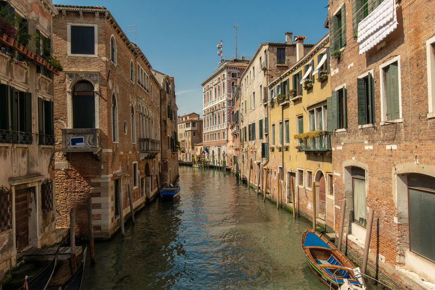 a small canal in Venice Venice, Italy Architecture Building Built Structure Canal City Clear Sky Day Italy Mode Of Transportation No People Outdoors Residential District Sky Transportation Venice Water Waterfront Window