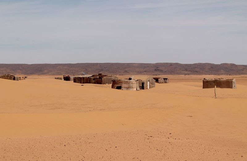 Mid Distance View Of Tents In Sahara Desert Against Sky