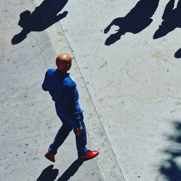 Shiny bald head, shiny red shoes. Bluejeans Redshoes Baldhead Shadows Walking Shiny Things Streetphotography 4thfloorphotography Tangiers,morocco Johnnywalker