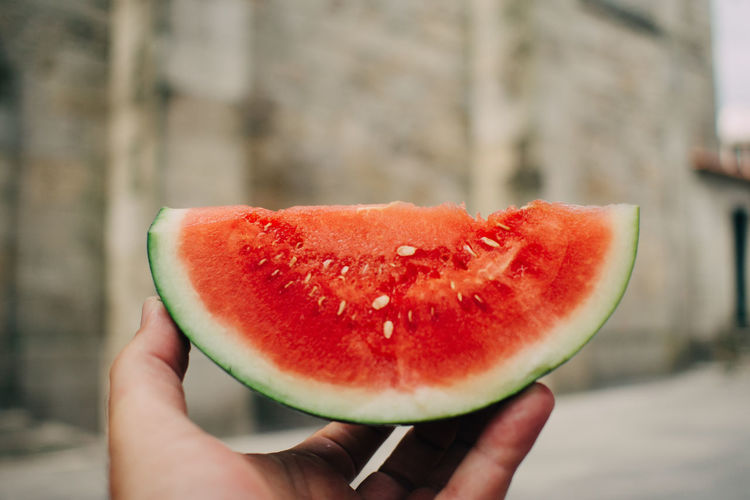 Cropped Image Of Person Holding Watermelon Slice