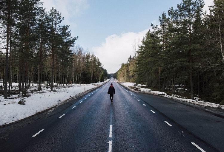 The Lonely Road Alone EyEmNewHere EyeEm Best Shots EyeEm Nature Lover Lonely Road Travel Trees Walk Winter Beauty In Nature Beauty In Nature Day Eyemphotography Forest Lifestyles Lonely Road Long Road One Man Only Outdoors Real People Sky Snow Snowy Walking