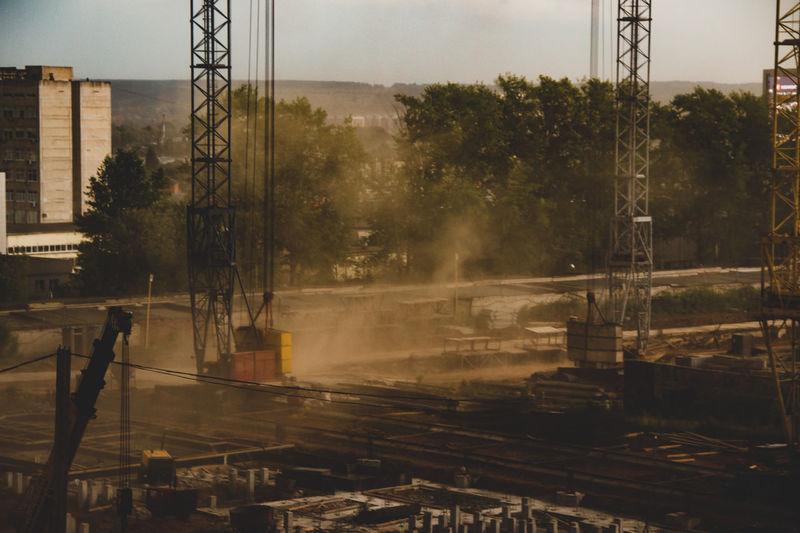 Dust storm at construction site / construction site