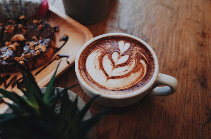Coffee with working Froth Art Cappuccino Frothy Drink Mocha Latte Drink Coffee - Drink Table High Angle View Coffee Cup Espresso Ground Coffee Black Coffee Hot Drink Coffee Beverage Froth Cup