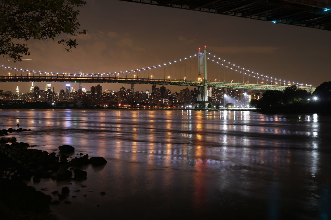 reflection, bridge - man made structure, water, illuminated, connection, architecture, river, built structure, tree, night, waterfront, no people, suspension bridge, outdoors, sky, nature, chain bridge