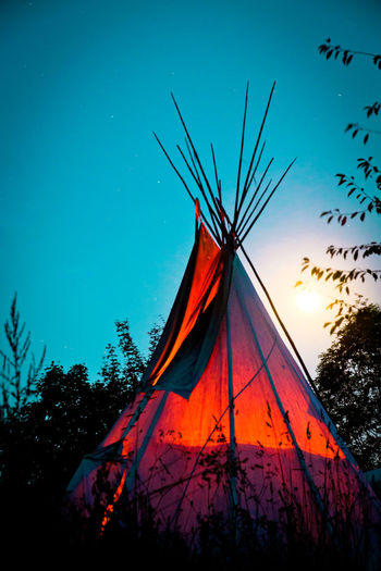 Blue Blue Sky Full Moon Landscape Lifestyle Native Native American Native American Indian Native American Life Native American Tradition Native Life Nature Night Night Sky No People Orange Color Outdoor Life Outdoors Sky Stars Teepee Tent Traditional Culture Tree