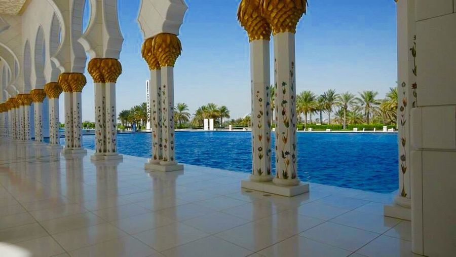 Sheikh Zayed Mosque Blue In A Row Architectural Column Architecture Built Structure Column Clear Sky Pillar Pole Building Exterior Water Travel Destinations Mosque Colonnade Tranquil Scene Place Of Worship Day Sky Tourism Tranquility The Architect - 2017 EyeEm Awards