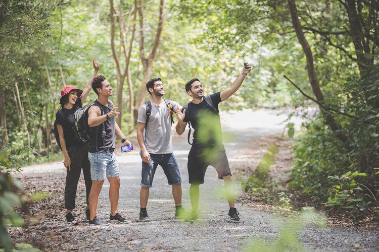 Friends enjoying in forest