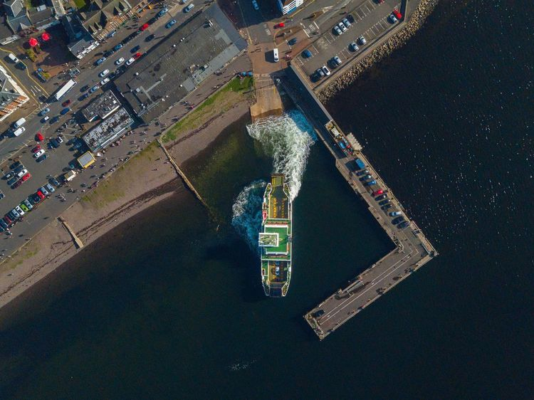 Ferry pulling out of Largs port, Scotland. Aerial View High Angle View Water Freight Transportation Building Exterior Nautical Vessel Transportation Shipping  Outdoors Cargo Container Built Structure Industry Day Cityscape Sea Architecture No People City Drilling Rig Oil Pump Ferry Boat
