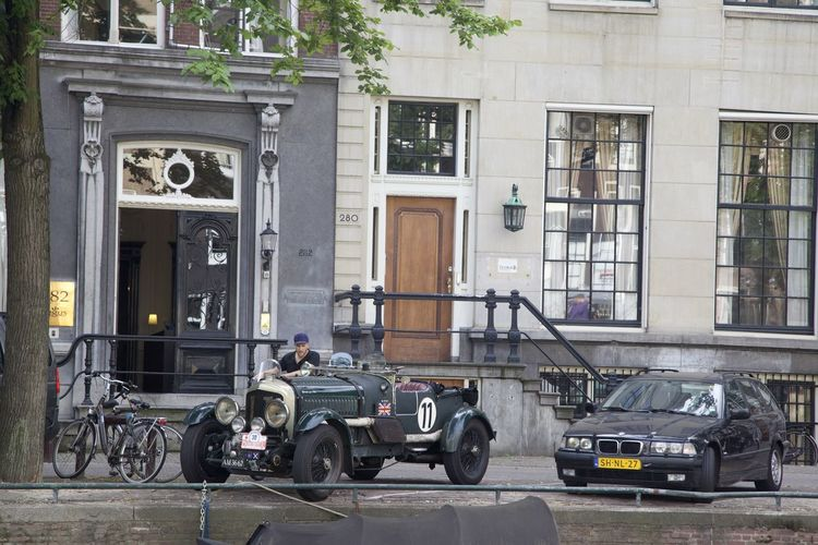 Cars on street against building in city