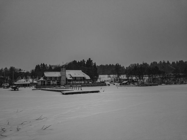EyeEmNewHere Cloud - Sky Clouds Black And White Winter Snow Frozen Lake Built Structure Outdoors Tranquility Beach Architecture Day Stilt House Tree No People Water Sky Nature Building Exterior