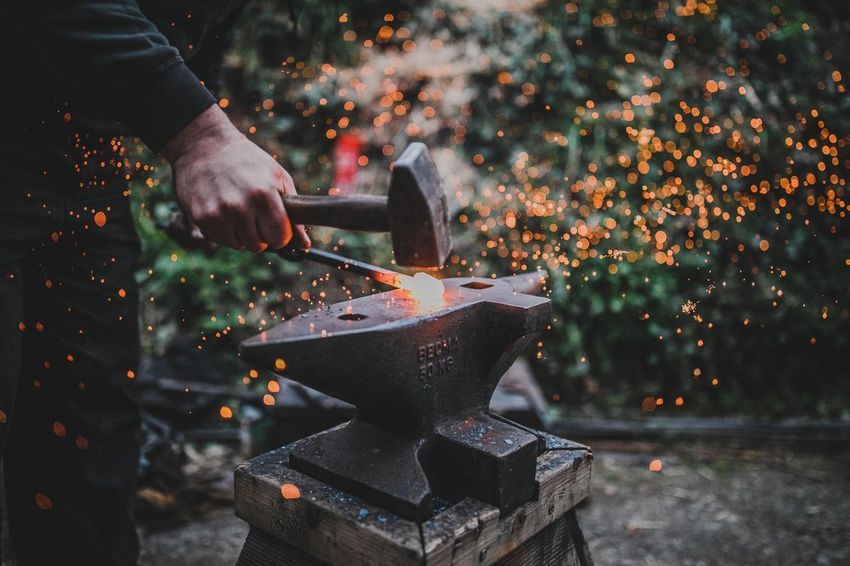 Blacksmith Iron Woring Blacksmith  EyeEm Selects One Person Hand Real People Human Hand Sparks Holding Fire - Natural Phenomenon Working Heat - Temperature Occupation Motion Blurred Motion Human Body Part Burning Fire Night Men Flame Work Tool The Photojournalist - 2018 EyeEm Awards