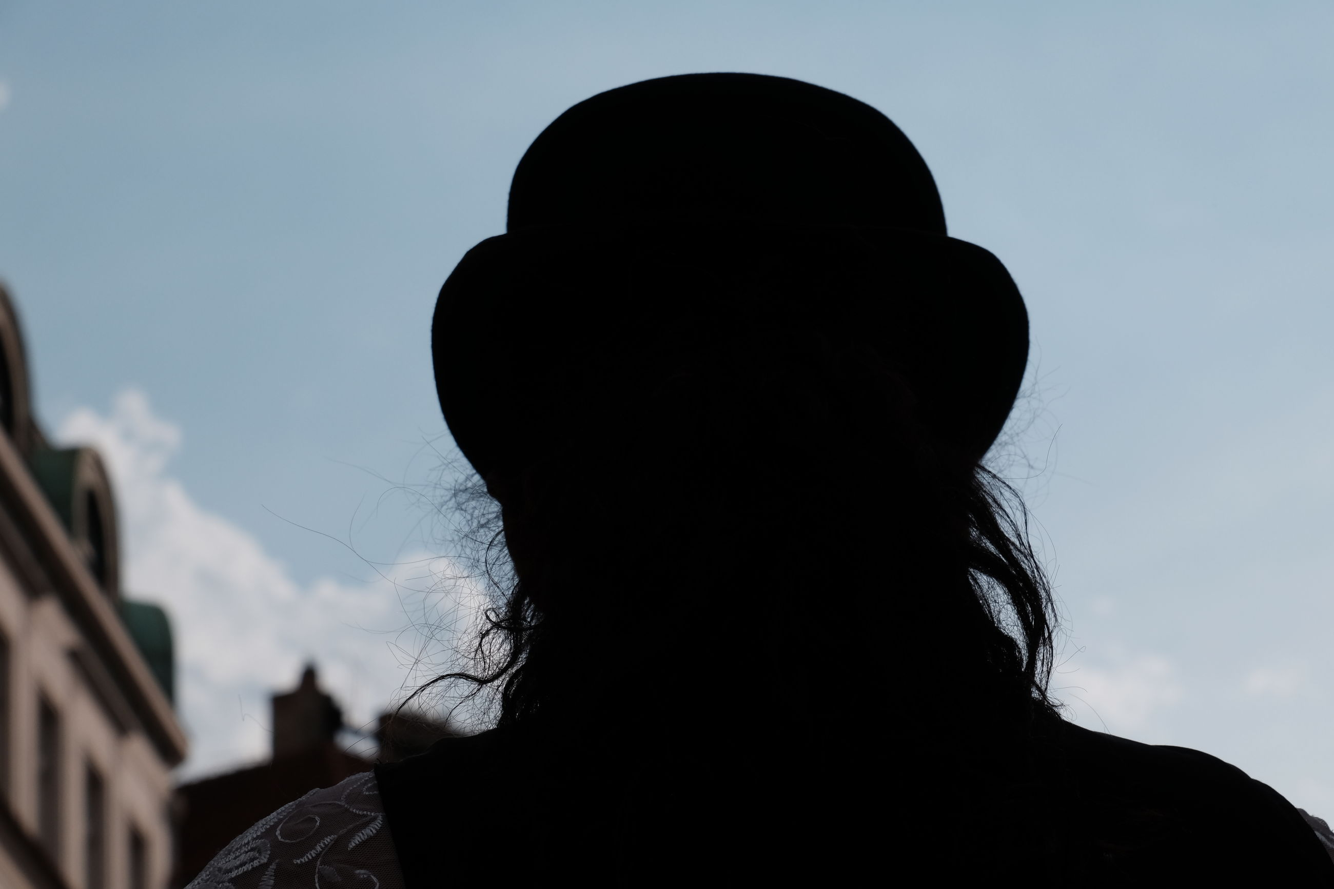 REAR VIEW OF SILHOUETTE PERSON AGAINST SKY