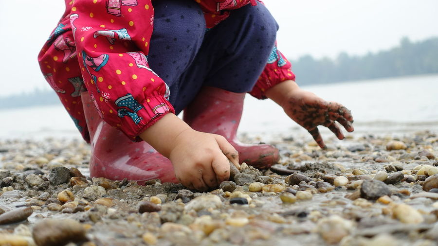 Beach Boots Close-up Girl Human Hand Nature One Person Outdoors Pebble Rainy Water