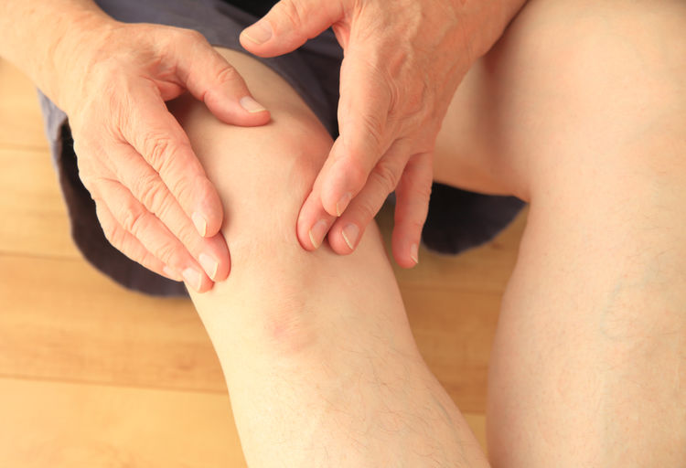 Cropped Image Of Senior Man Touching Sore Calf