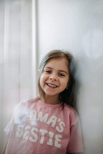 Mamas Bestie 💕 Text Childhood Smiling Girls Real People Happiness One Person Front View Elementary Age Casual Clothing Looking At Camera Indoors  Lifestyles Communication Leisure Activity Portrait Standing Cheerful Cute Day