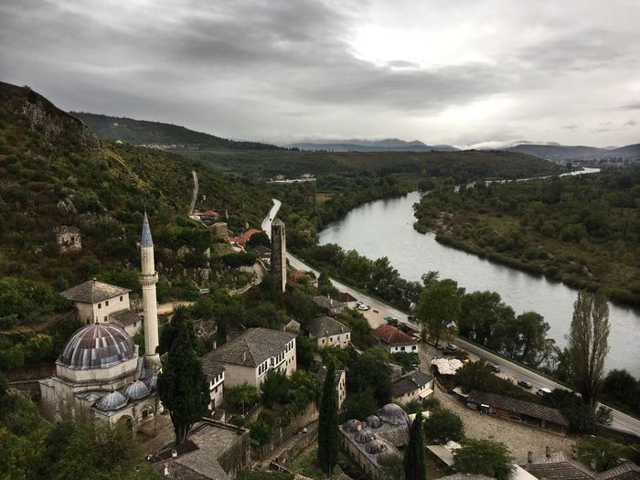 Scenic view of river against cloudy sky