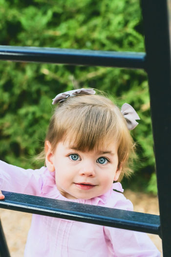 Childhood Child Portrait Real People One Person Looking At Camera Girls Cute Females Leisure Activity Lifestyles Innocence Day Focus On Foreground Women Headshot Front View Outdoors Bangs Blue Eyes Lovely