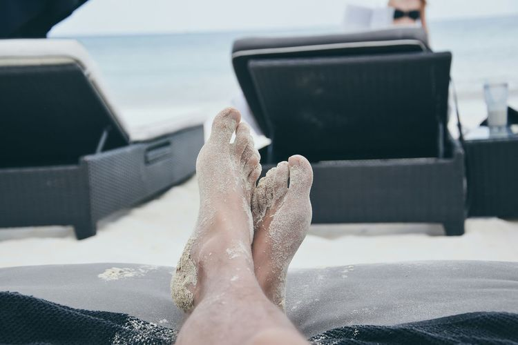 Person With Messy Legs Relaxing On Lounge Chair