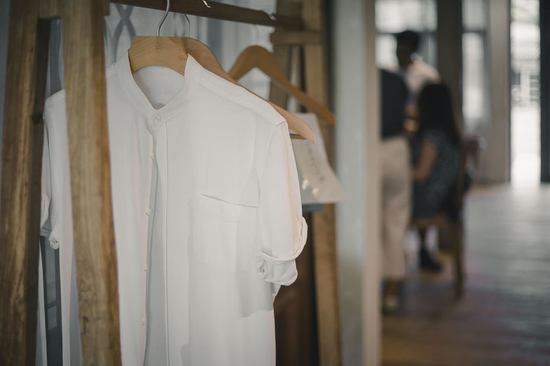 White clothes hanging on door