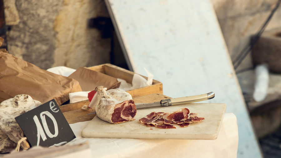French cured meat tasting in open air market stand Annecy, France Food Tasting Haute Savoie Market Tasting Cured Meat Cutting Board Food Food And Drink French French Food Kitchen Knife Market Stall Open Air Market Table Wood - Material