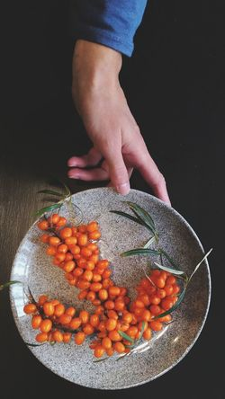 Sea Buckthorn Human Hand Healthy Lifestyle Vegetarian Food Fruit Black Background Close-up