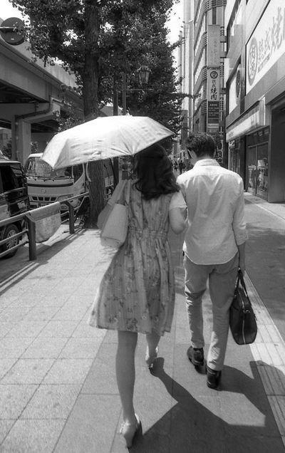 Streetphotography Street Photography Tokyo Black And White Blackandwhite Film Photography Film City Real People Building Exterior Street Full Length Walking Architecture Adult Women Umbrella Protection Built Structure City Life Casual Clothing Lifestyles People Day Rear View Leisure Activity Outdoors