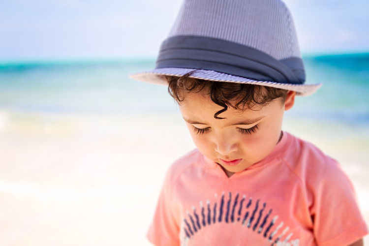 Rear view of boy looking at sea shore