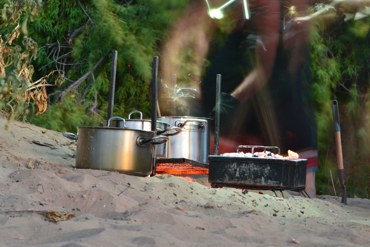 Blurred Motion Of Person Cooking Food Outdoors