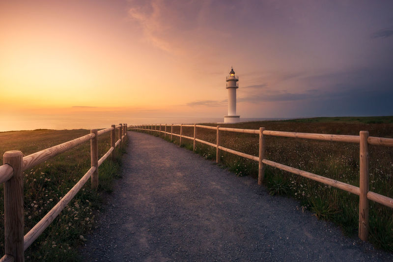 Lightouse in the north of Spain Lighthouse Lighthouse Lovers Lighthousephotography Landscape Colour Low Angle View Spain, Andalucia, Malaga Cantabria Faro De Ajo. Wood Composition Light Sun Summer Sunset Sunrise Travel Europe Outdoors