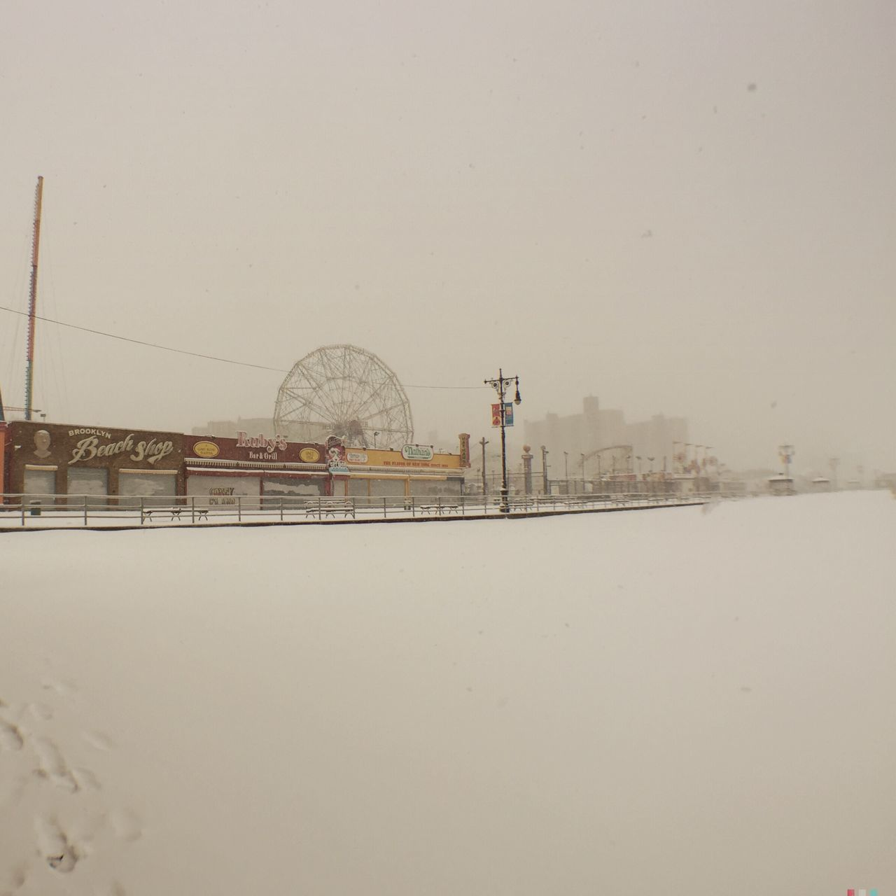 Scenic View Of Amusement Park At Foggy Climate