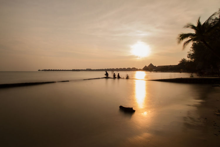 this picture was a long exposure capture at Pantai Bagan Lalang, Sepang, Beach Beauty In Nature Cloud - Sky Land Outdoors Reflection Scenics - Nature Silhouette Sky Sunset Tranquil Scene Water