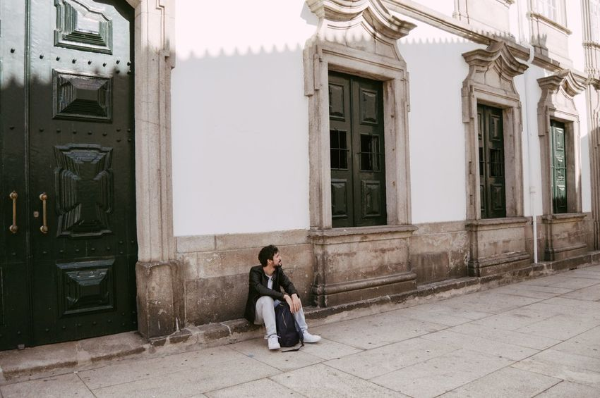 Waiting Boy Vacations Sitting Alone City Sitting Full Length Door Window Architecture Building Exterior Built Structure Doorway Entryway Entrance Closed Stories From The City